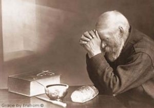 Grace is a photograph by Eric Enstrom. It depicts an elderly man with hands folded, saying a prayer over a table with a simple meal. In 2002, an act of the Minnesota State Legislature established it as the state photograph.